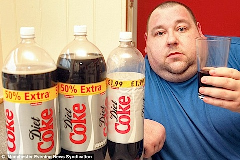 fat man drinking diet coke